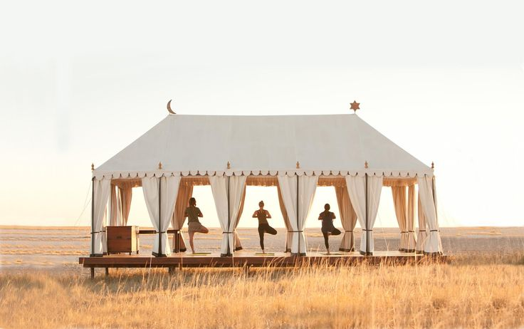 Sun salutations at San Camp in #Botswana. #Africa #travel #yoga #summer