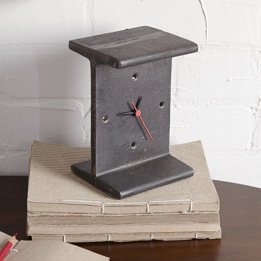 The minimalistic design, steel frame and matte finish of the I-Beam Clock lends an industrial vibe to desks, bookcases or consoles.