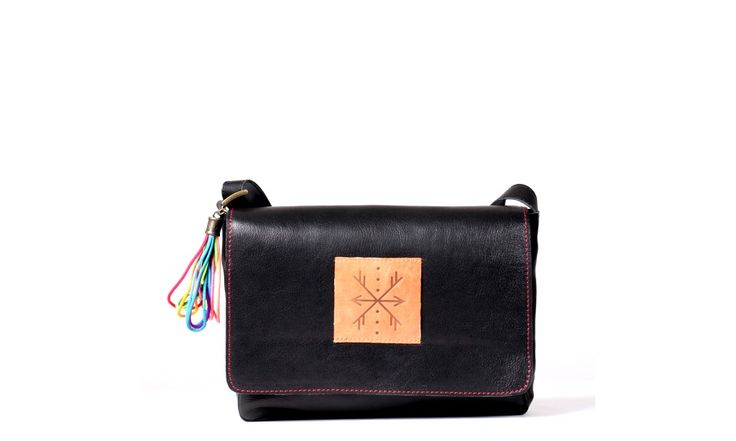 Main body is made of the best quality natural leather (grain leather). Inside: zipped  pocket, leather lining, key leash. Zipped pocket under the flap. Accessories in antique gold color. Colorful fringe/pendant inside. Color- black.