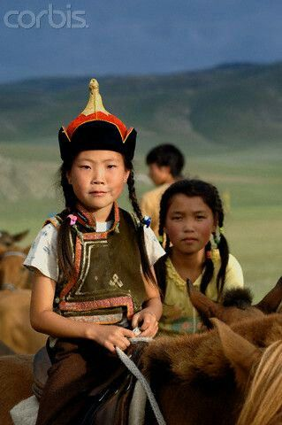 Asia | Portrait of a girl on a horse, Mongolia