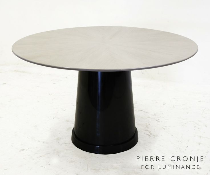 This round table by Pierre Cronje has a light grey Zebrano top with a high gloss finish, and a French Polished black base in Mahogany.