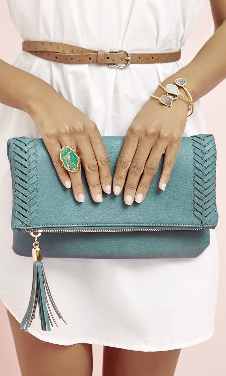 Soft vegan leather foldover clutch in teal, with beautifully braided side detailing and a tassel along the zipper