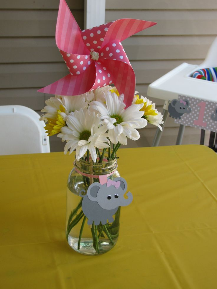 Elephant & Pinwheels First Birthday Party - Pinwheel & Daisy centerpieces in mason jars tied with a card stock elephant.