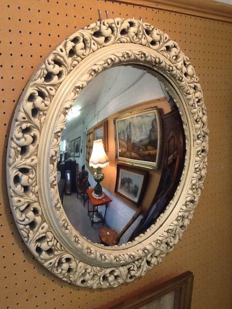White plaster framed convex mirror.