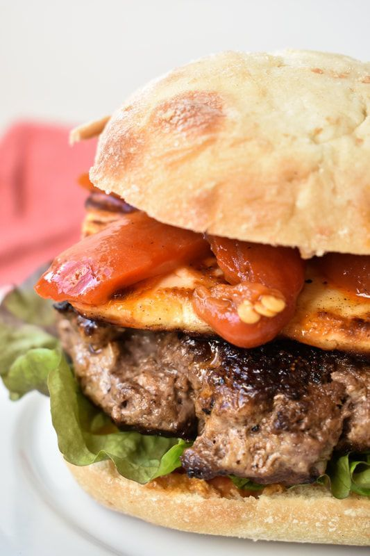 Roasted Red Pepper and Grilled Halloumi Burger - Prairie Winds Life  Burger number 4 of the burger series on Prairie Winds Life. A spicy, salty, sweet burger that is juicy and you need two hands to eat!  #burger #grilled #redpeppers #roasted #recipe #bbq #prairiewindslife #fbc #foodblogger #food #sandwich #halloumi