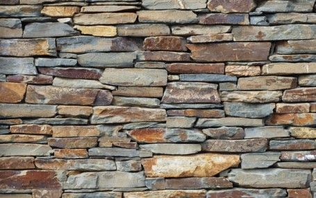 Yosemite Slate Ledger Stone.  Stately, grey, blue-gray and black colored Yosemite slate ledger stone veneer with specks of red, purple and yellow sold in 2″ to 6″ thick pieces.  Approx. coverage 35 sq. ft./ton.  Bourget Brothers, Santa Monica, CA