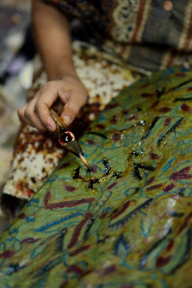 The process of making Indonesian batik by using wax. Solo. Indonesia.