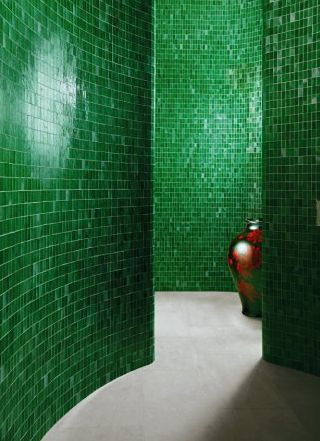 The emerald tile adds polish to this amazing walk-in shower space.