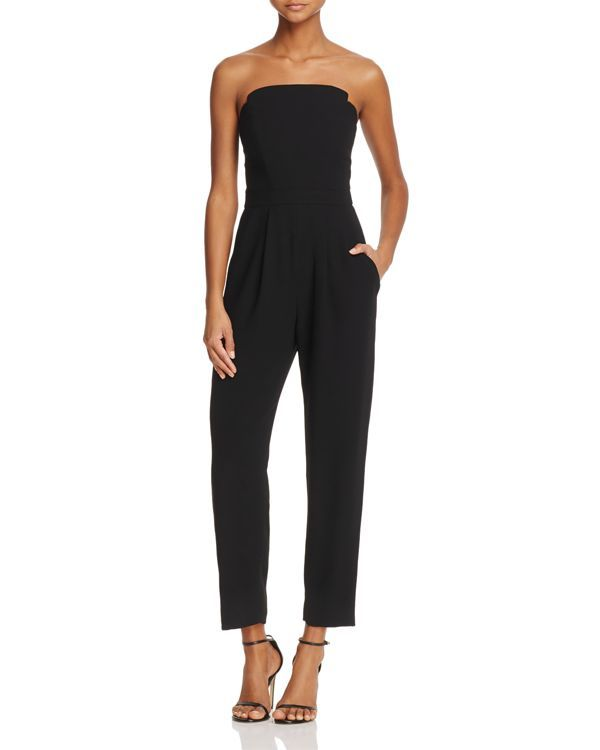 With a one-and-one design in a sleek, strapless silhouette, this Jill Jill Stuart jumpsuit is as effortless as it is elegant. | Polyester; lining: acetate | Dry clean | Imported | Fits true to size, o