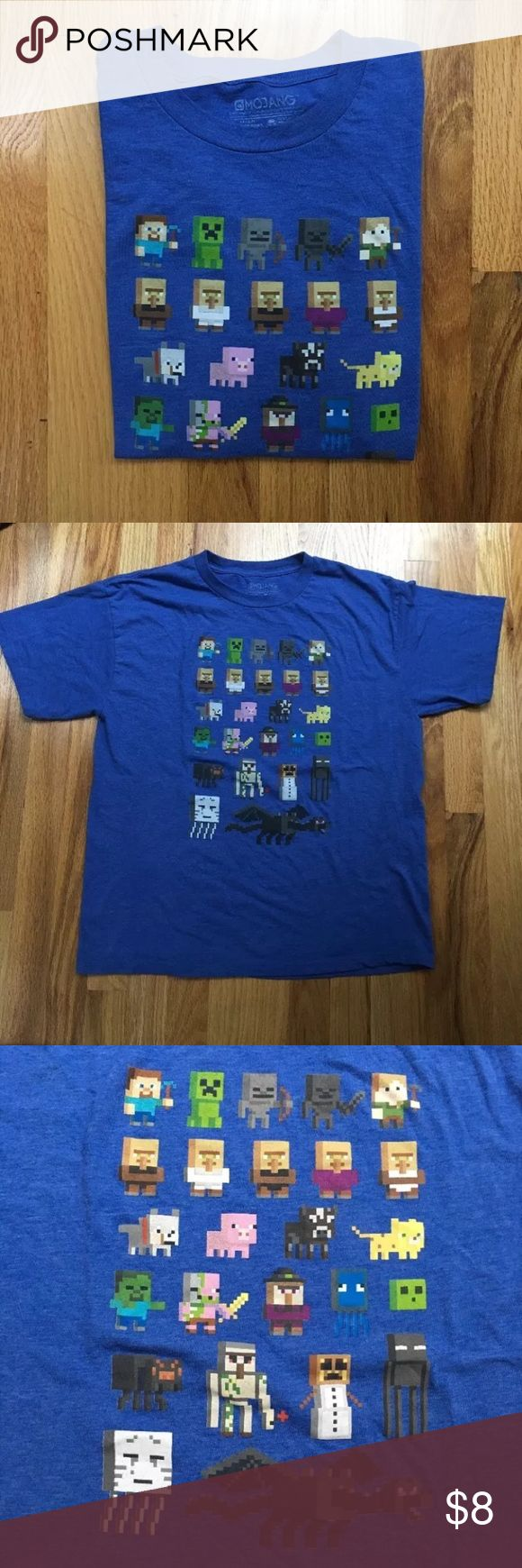 "Mojang Minecraft Boy's Short Sleeve Shirt Mojang Minecraft Boy's Short Sleeve Shirt SZ 2X (18) Blue Cotton JINX.---  Measurements Laying Flat: Approx. Full Chest: Armpit to Armpit: 20"" Length: Shoulder to Hem: 25"" Armpit to Hem: 14.5""   Sleeve Opening: 8"" Sleeve Across: 9"" Sleeve Length: 8.5"" Shirts Tees - Short Sleeve"