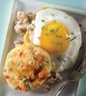Biscuits & Sausage Gravy  INGREDIENTS:      5 tbsp cold organic unsalted butter     3 1/2 cups whole milk divided     1 tbsp white or apple cider vinegar     1 3/4 cups plus 1/2 cup white whole-wheat flour divided plus additional for dusting     1/2 cup stone-ground yellow cornmeal     1 1/2 tsp baking powder     1/2 tsp baking soda (TRY: Bobs Red Mill Baking Soda)     1/4 plus 1/2 tsp sea salt divided     4 scallions light green and green parts only sliced     3 piquillo peppers patted dry…
