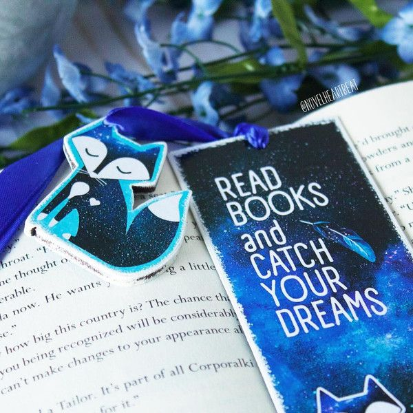 "Unique 2-sided handmade dreamcatcher bookmark with quote ""Read books and catch your dreams"" on one side and galaxy dreamcather picture on another. Finished with wooden fox charm on a..."