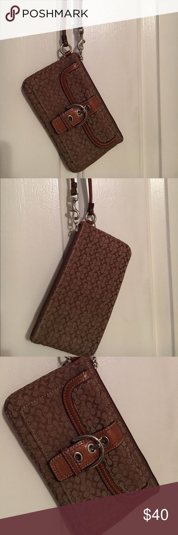 Coach Wristlet Coach wristlet with signature C print. Buckle and small pocket in the front. More storage in the zipper.  Used Coach Bags Wallets