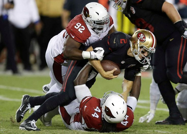 Thursday Night Football: Cardinals vs. 49ers  -  October 6, 2016:  33 - 21, Cardinals  -     San Francisco 49ers quarterback Blaine Gabbert (2) is sacked by Arizona Cardinals outside linebacker Markus Golden (44) as defensive end Frostee Rucker (92) follows during the second half of an NFL football game in Santa Clara, Calif., Thursday, Oct. 6, 2016.
