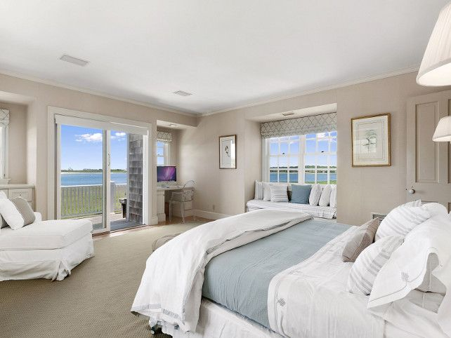 Bedroom. Neutral Bedroom. Neutral beach house with beige walls, white and blue bedding and window seat with white cushion and pillows. #Bedroom