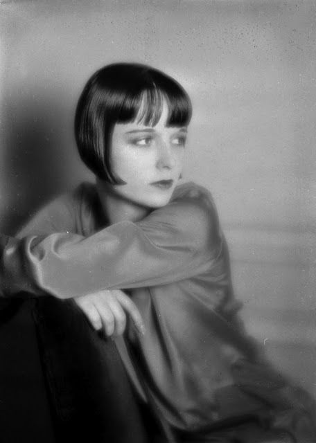 Louise Brooks My mother has photos of herself and her hair, somber look, makeup all look like this beauty.
