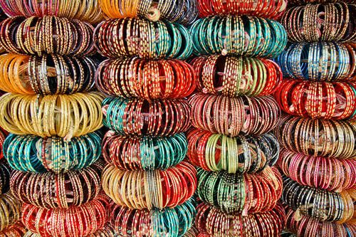 Glass Bangles are traditional ornaments worn mostly by South Asian women in India, Pakistan and Bangladesh. It is a common tradition to see a new bride wearing glass bangles at her wedding. Bangles also have a very traditional value in Hinduism and it is considered inauspicious to be bare armed for a married woman.Chooda is a kind of bangle that is worn by Punjabi women on her wedding day. It is a set of white and red bangles with stone work.