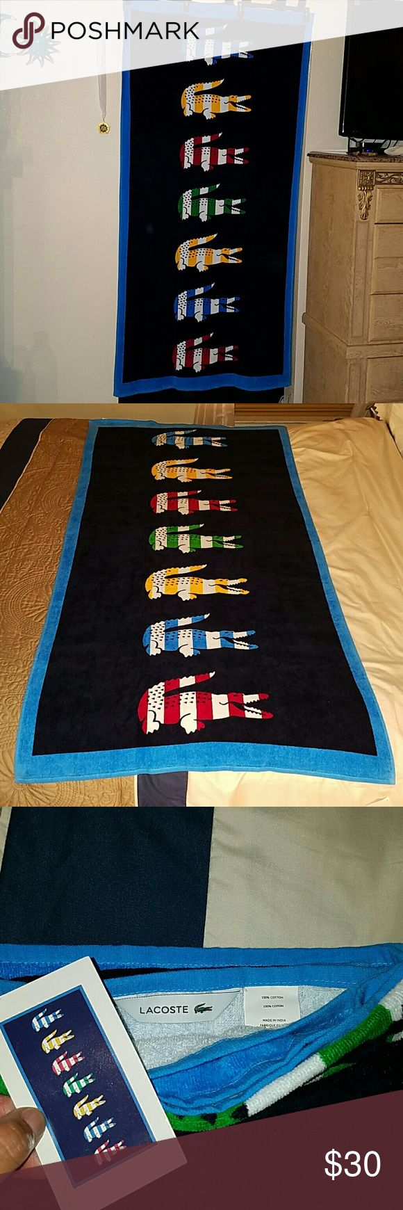 Lacoste large beach towel Oversized beach towel with striped crocodiles across. Great for beach or just shower....brand new. Lacoste Accessories