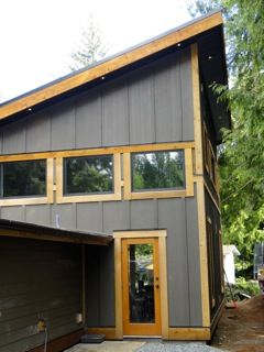 Corrugated metal siding - a great cladding for straw bale, esp. into the prevailing wind.