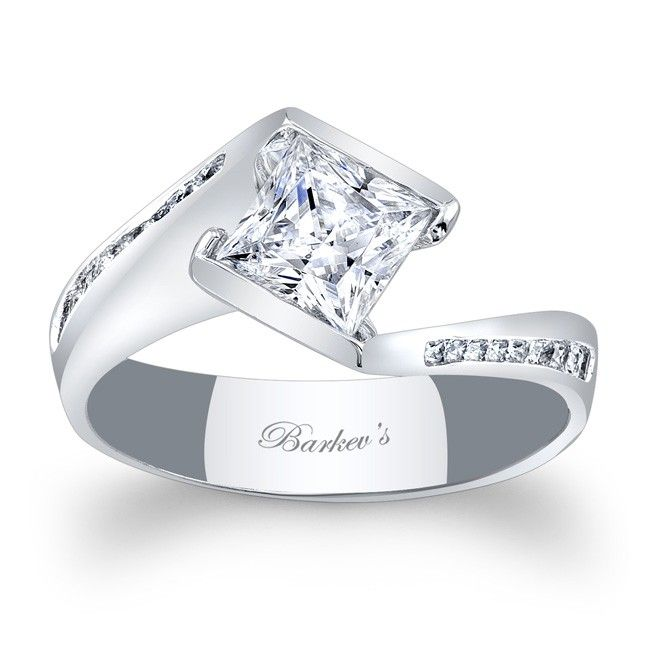 A bold contemporary twist on a vintage bypass ring this diamond engagement ring is a dazzler.  The channel set princess cut diamond is captured by the split cathedral shank, while channel set diamond adorn the ridges. <br /> <br /> Also available in rose, yellow gold, two tone, 18k and Platinum.