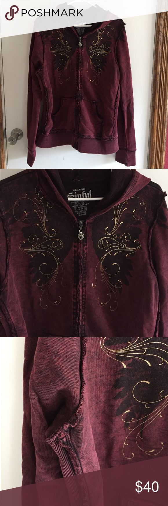 EUC Sinful Zip Up Hoodie XL Excellent condition! Raspberry colored hoodie with gold/black detail and the back has black wings with gold detail. Seams have a distressed look. Washed cold and hung to dry, smoke free home. Sinful Tops Sweatshirts & Hoodies