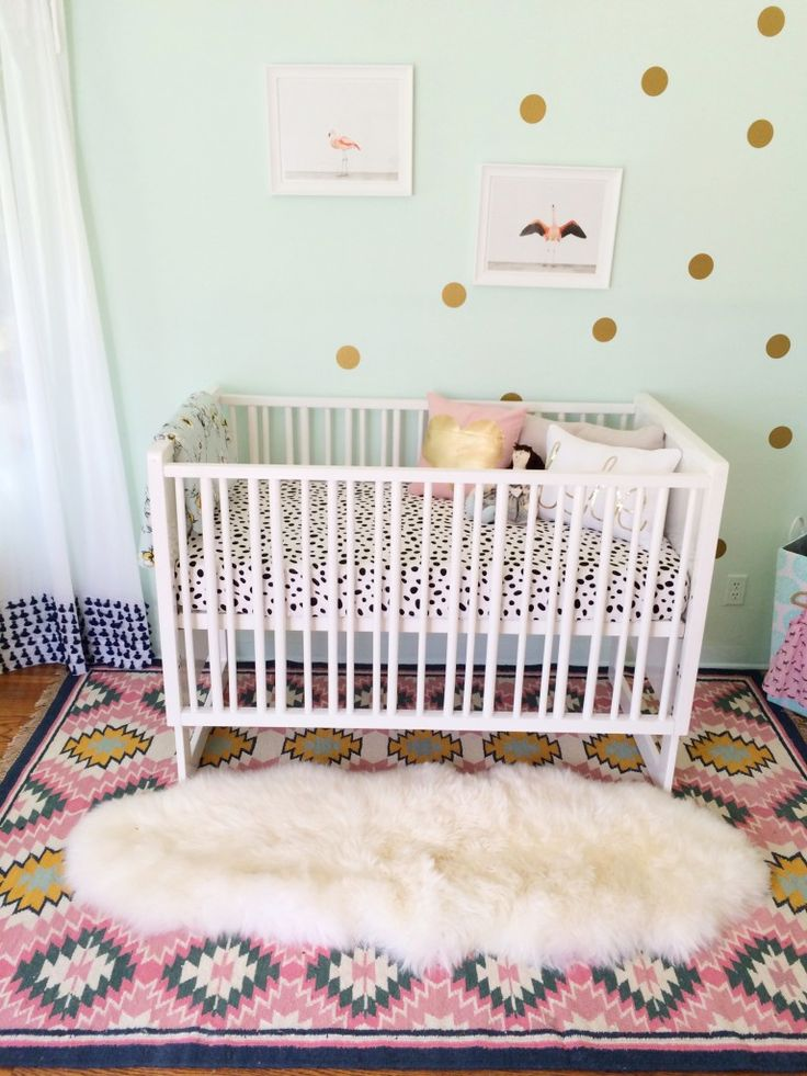 Don't be afraid to mix patterns, colors and textures in the nursery! But only choose items that you really love. #Nesting:  Cots, Mint Wall, Nurseries, Baby Girl, Cribs, Gold Dots, Desert Rugs, Girls Rooms, Paintings Desert
