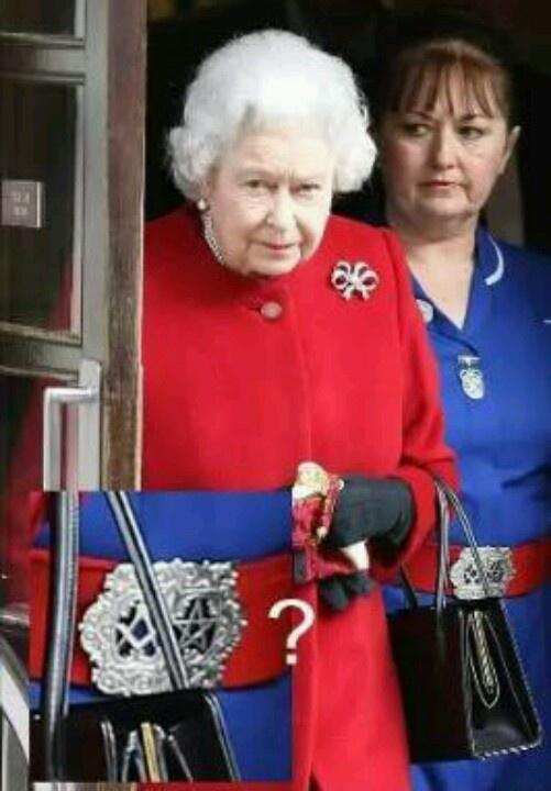 Queen's nurse wearing a pentagram & masonic belt buckle. EVIL!