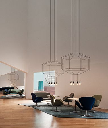 House space with high ceiling and wire framed chandeliers