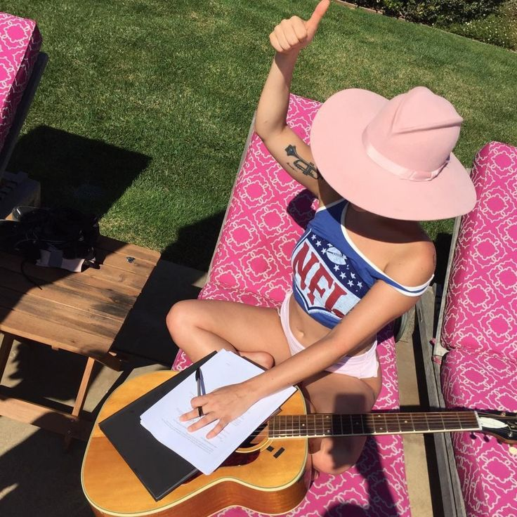 The Style Lessons We've Learned From Lady Gaga: The Style Lessons We've Learned From Lady Gaga: Lady Gaga practically puts on a show with her outfits alone, and after a few years of seeing her in the spotlight, we've picked up tons of styling tips. -- Pink cowboy hat and NFL football crop top. | Coveteur.com