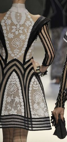 inspiration - designer unknown - Love the architecture of this dress, hard lines contrasting with soft lace.