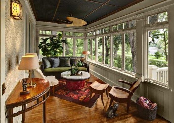 Long, narrow sunroom. Nice wooden windows... maybe longer?