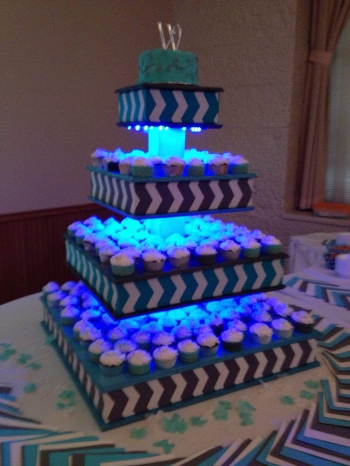 Using glow Sticks to light up cupcake stand...or use battery operated led lights.