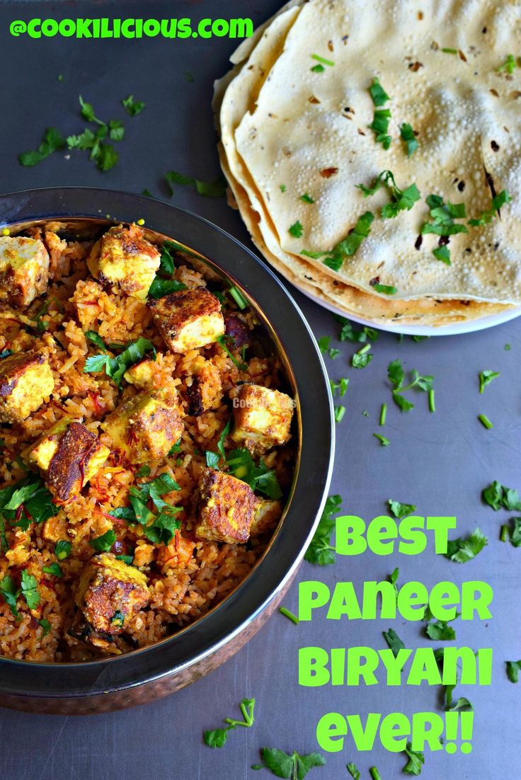 Spicy Paneer Biryani - Cookilicious -  is an Indian rice preparation cooked with whole spices, saffron and paneer. It's spicy flavor enhances this dish even more. Is best served with roasted papad and raita.