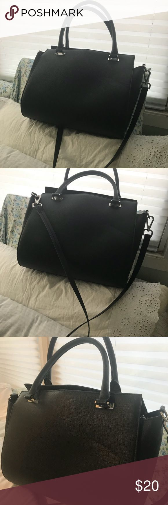 Structured H&M Doctor Bag Black Satchel Cross Body This is a fabulous structured Doctor type handbag by H&M. It's in excellent barely touched condition. Roomy enough to hold absolutely everything you need!! Black fabric lining. A great bag you will love!! And it works cross body with the long adjustable strap. H&M Bags Crossbody Bags