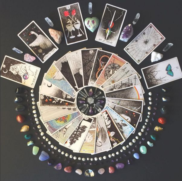what is your tarot mandala telling you? the wild unknown image via @crystalsandsage  mandala, crystals, tarot spread, tarot reading, tarot cards