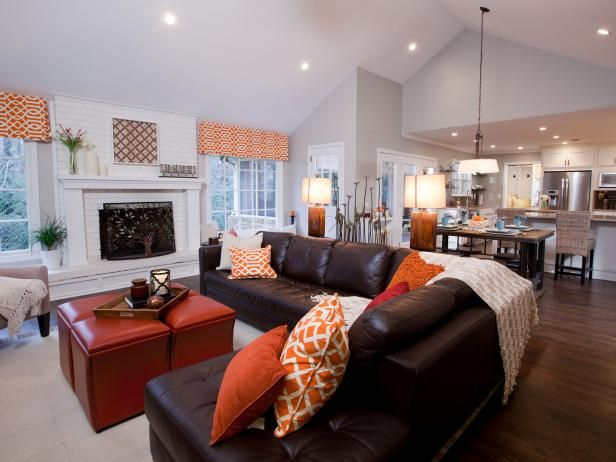 See the luxurious brown leather sectional and grand white fireplace in this open-concept living room on HGTV.com.