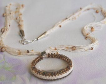 A necklace with a large pendant - a magnifying glass - Etsy