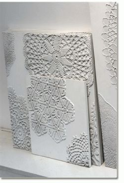 Secure doilies to a blank canvas and then paint over the doily and the canvas with a flat white paint. - I would use colors, paint underneath canvas in one solid, spray paint doilies in other solid colors, mod podge together (greens/blues)