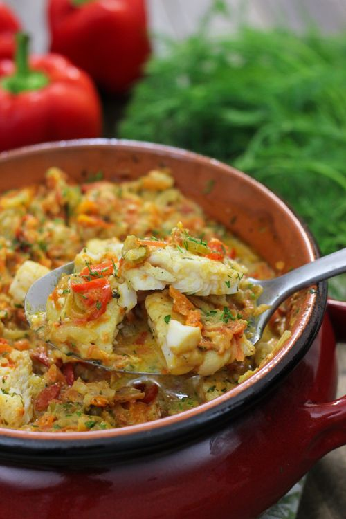 Baked White Fish and Vegetables~ Juicy and tender white fish, with a great abundance of vegetables – onions, carrots, celery, bell pepper, tomatoes, garlic and fresh herbs.