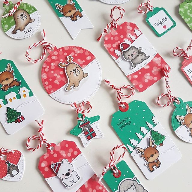 Love these Christmas tags, which red and green popping out of the white. Plus, gotta love the little animals...Great Tags!