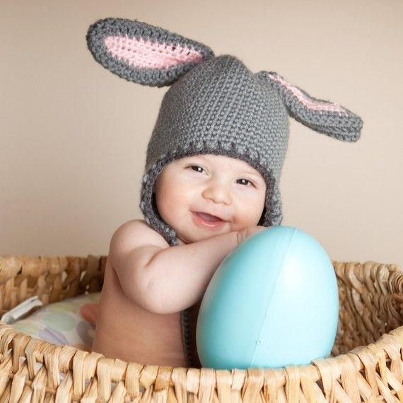 Rabbit Hat with Bunny Ears and earflaps.    It was made with soft, high quality, 100% acrylic yarn and is machine wash and dry, but with all