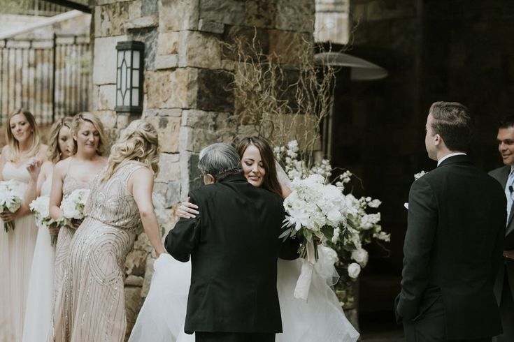 Bride and dad hug each other