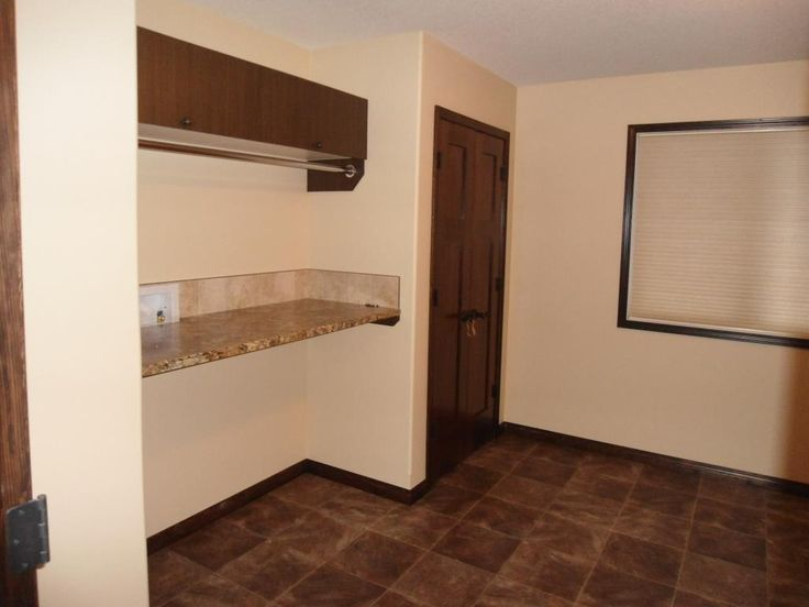 Large custom laundry room with hanging space, and folding counter #laundry