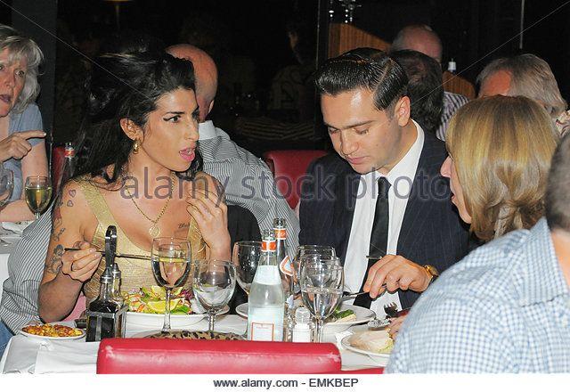 20.JUNE.2010. LONDON   AMY WINEHOUSE AND NEW BOYFRIEND REG TRAVISS ATTEND HER…