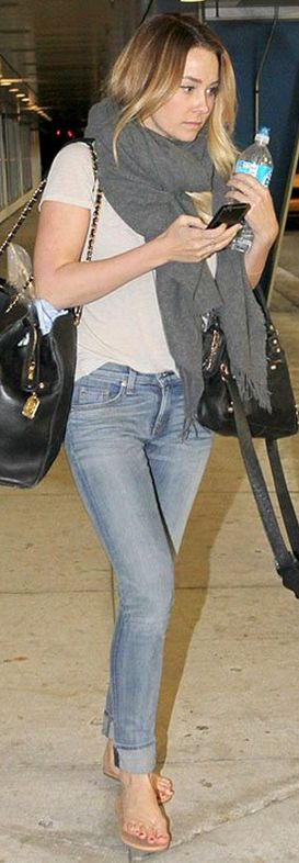 Who made  Lauren Conrad's black bags and nude flip flops that she wore in Miami on February 28, 2013?
