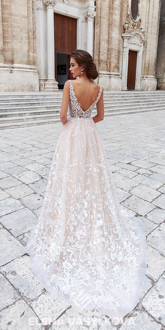 My new favourite wedding ceremony robe. I like the lace and the low v again. Very elegant