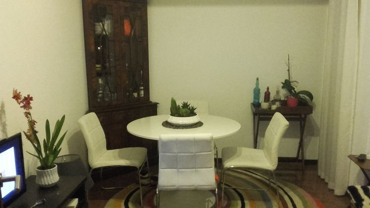 Small living and dinning room combo. Round table.