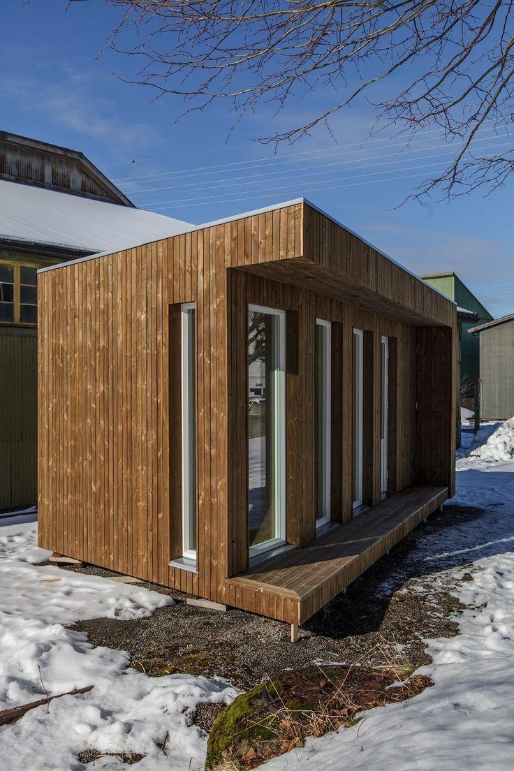 Mini-hus med kledning i Kebony