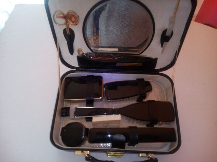 Vintage gents grooming travel kit in black leather case with key