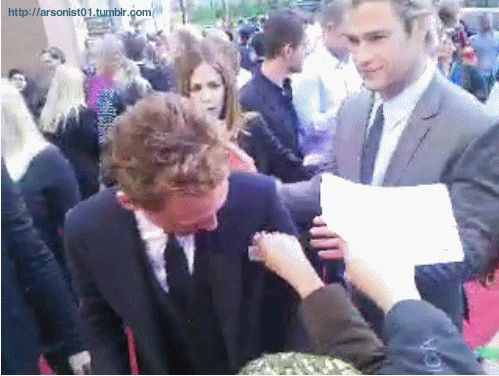How Chris sneaks up on Tom and rubs his arm (gif)   Chris Hemsworth And Tom Hiddleston Have The Hottest Bromance To Ever Exist